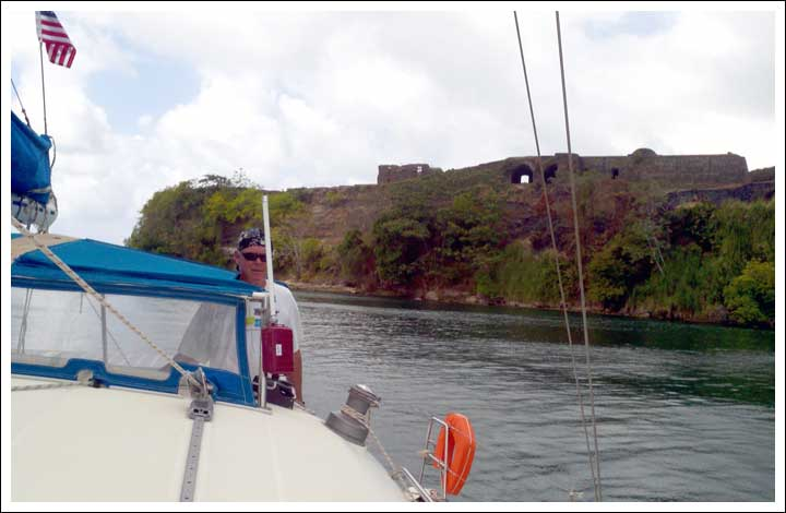 Squeezing Past the Fort San Lorenzo Cliff