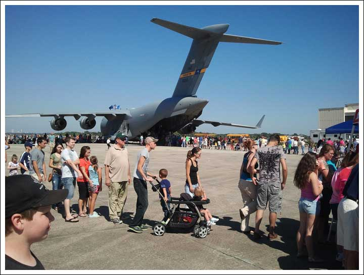 The People in the Foreground are Part of the Same Line as Those Going in the Aircraft