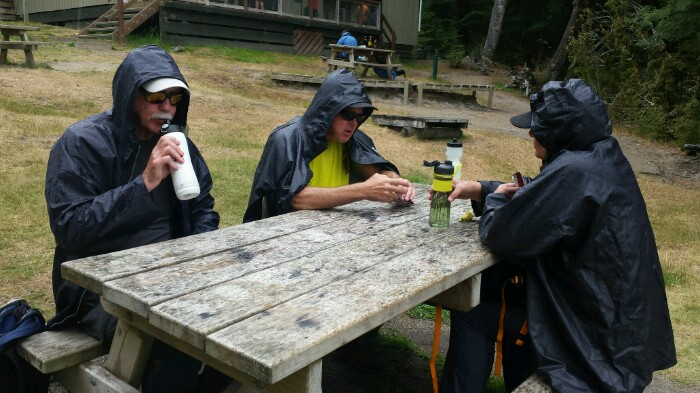 Ron, Deb, Chuck @ picnic table-700x393
