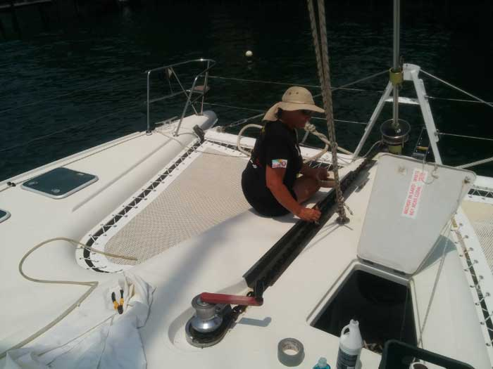 Oiling the Anchor Chain in the Guatemala Heat